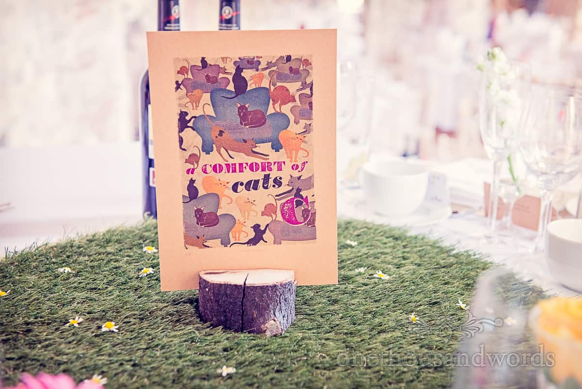 Comfort of Cake wedding table name sign in wood on plastic grass