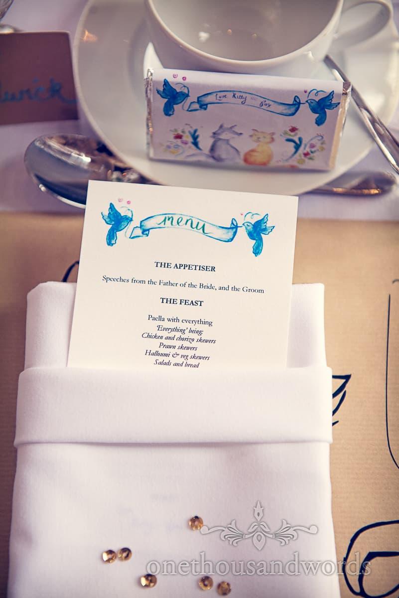 Custom designed wedding menu and custom designed wedding chocolate