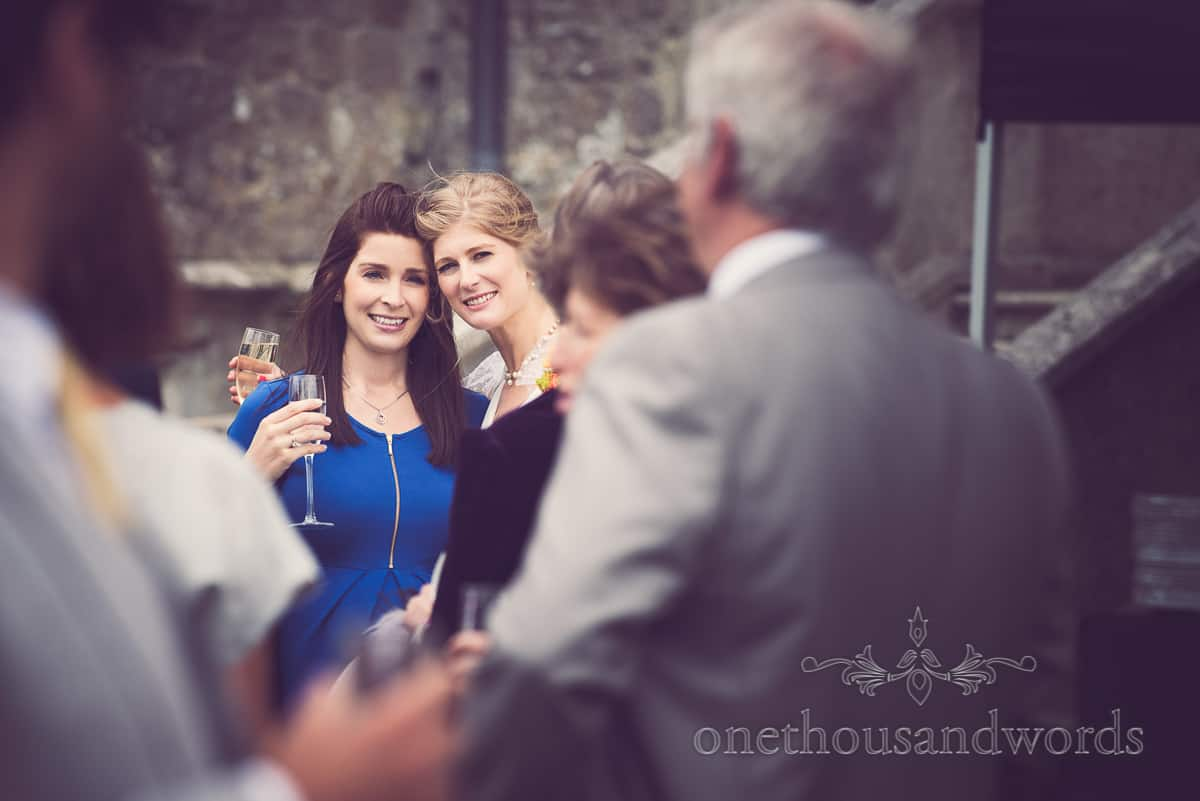 Bride and guest pose for photographs at Lulworth Castle Wedding