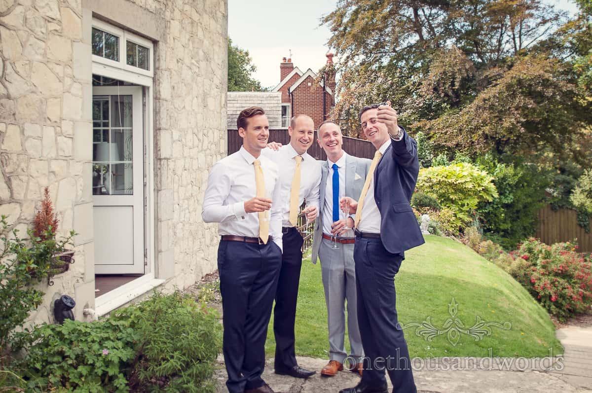 Groomsmen take delfies on wedding morning in Dorset