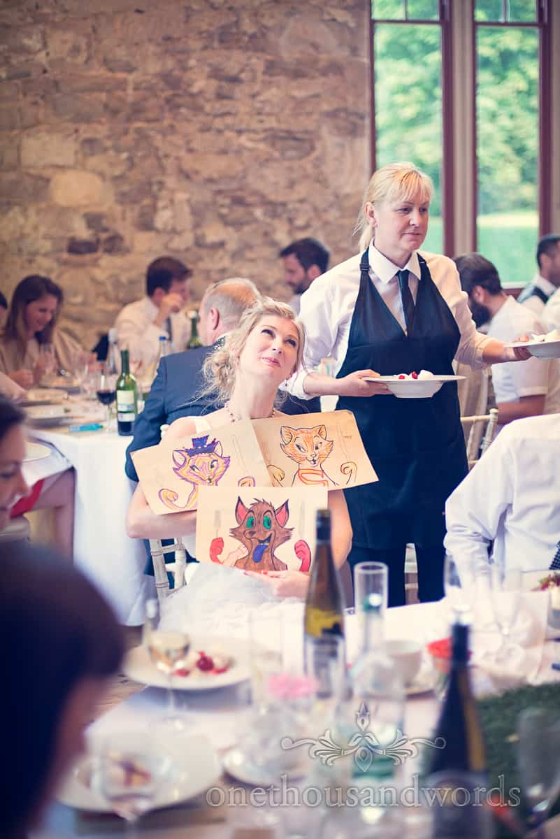 Bride with pictures coloured in by child wedding guests