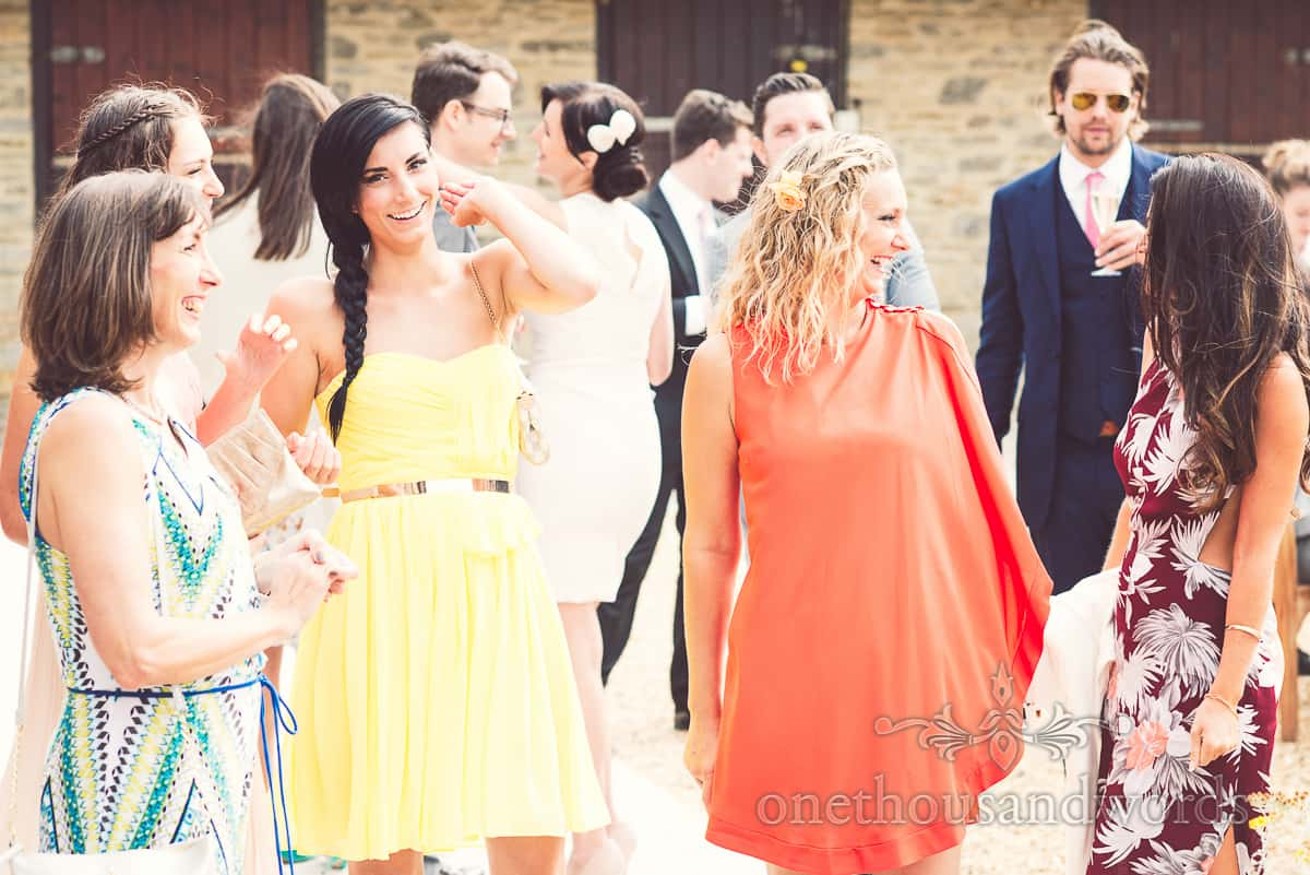 Colourful wedding guests at Stockbridge Farm Barn