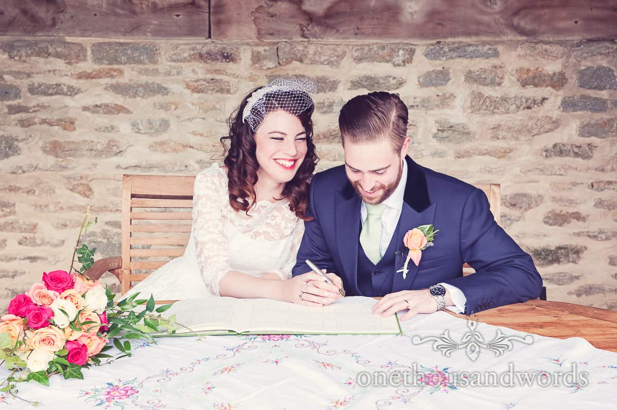 Signing the register at Stockbridge Farm Barn wedding photographs