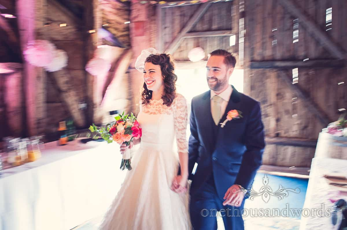 Bride and groom enter Stockbridge Farm Barn