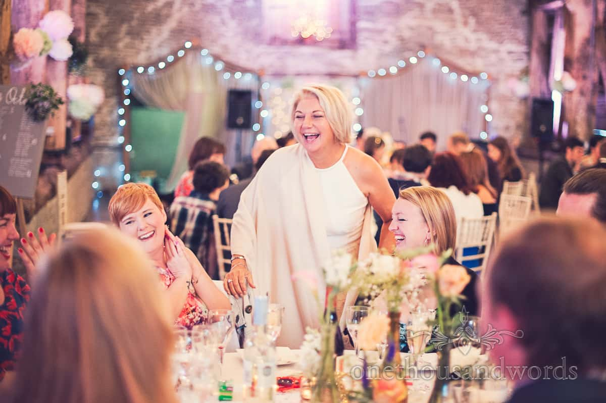 Laughing wedding guests at Stockbridge Farm Barn wedding