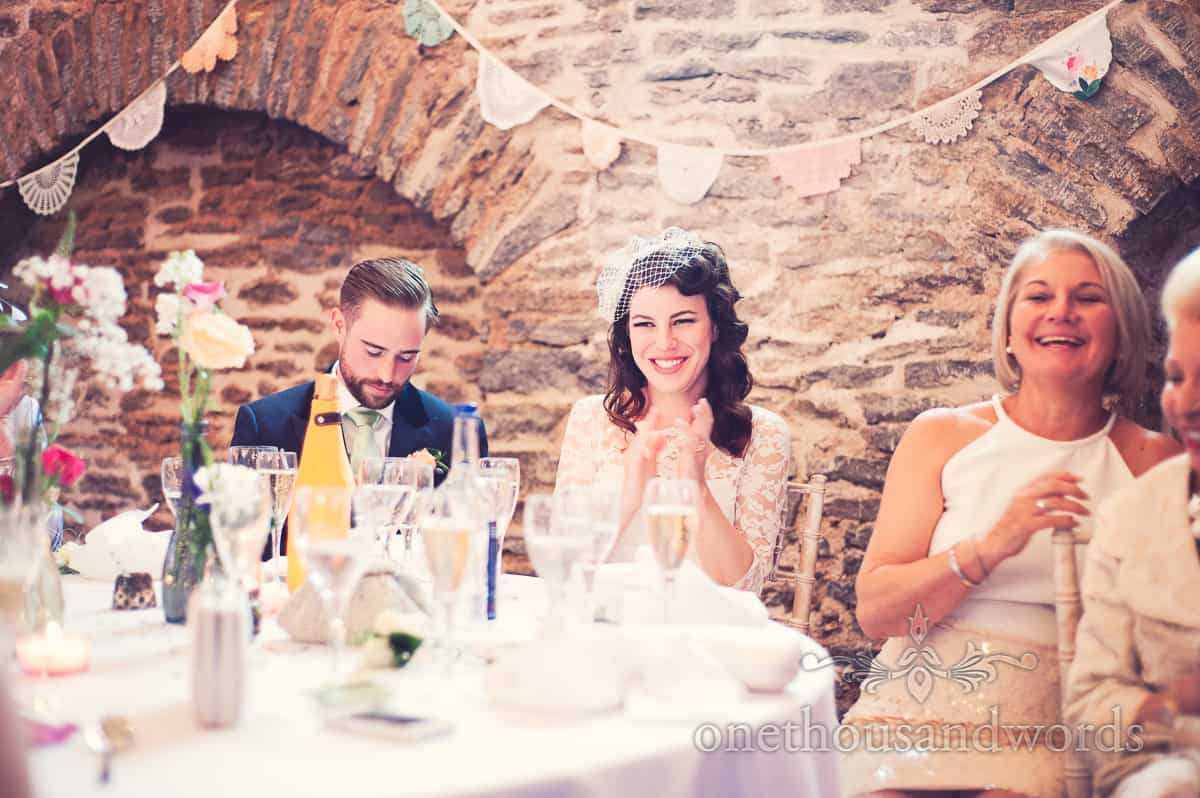 Bride and groom during wedding speeches at Stockbridge Farm Barn