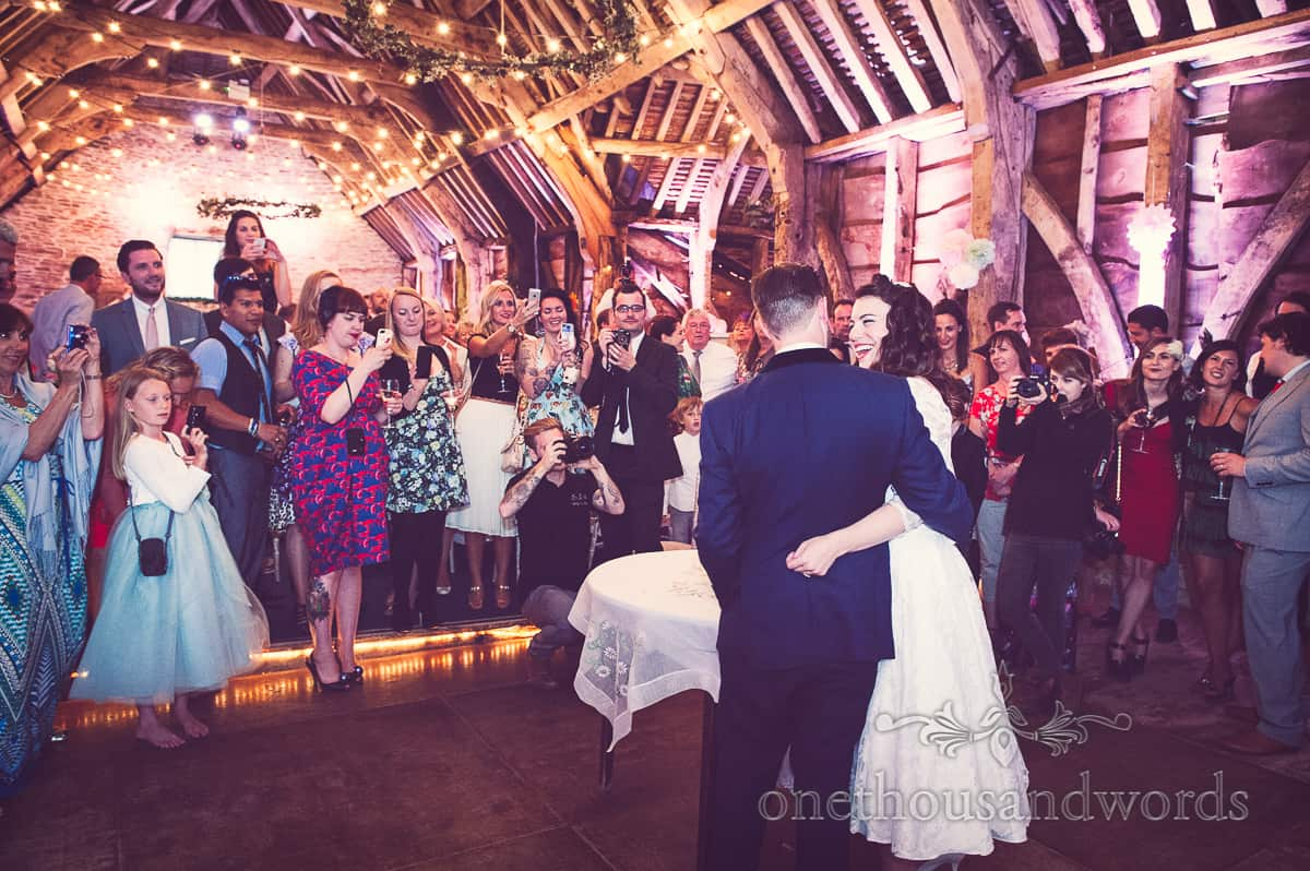 Cutting the cake Stockbridge Farm Barn wedding photographs