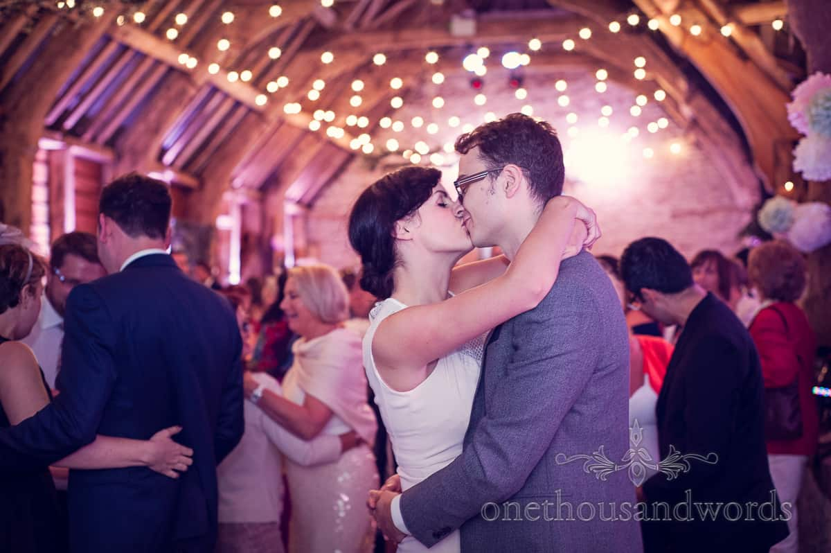wedding guests kiss in Barn