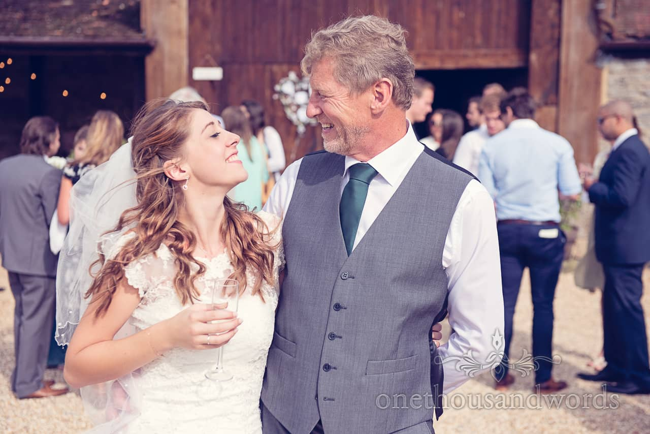 Bride and father at Guests hug at Dorset Barn Wedding