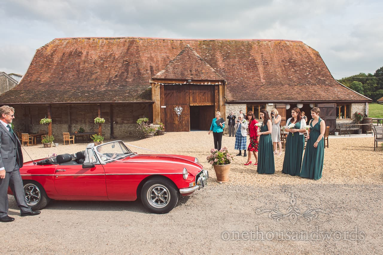 red wedding sports car at Stockbridge Farm Barn
