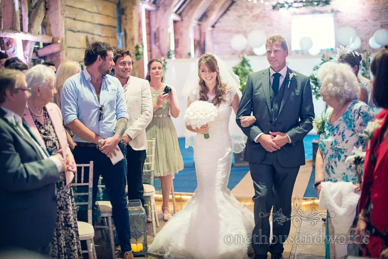 bride and father walk down aisle at Dorset Barn Wedding