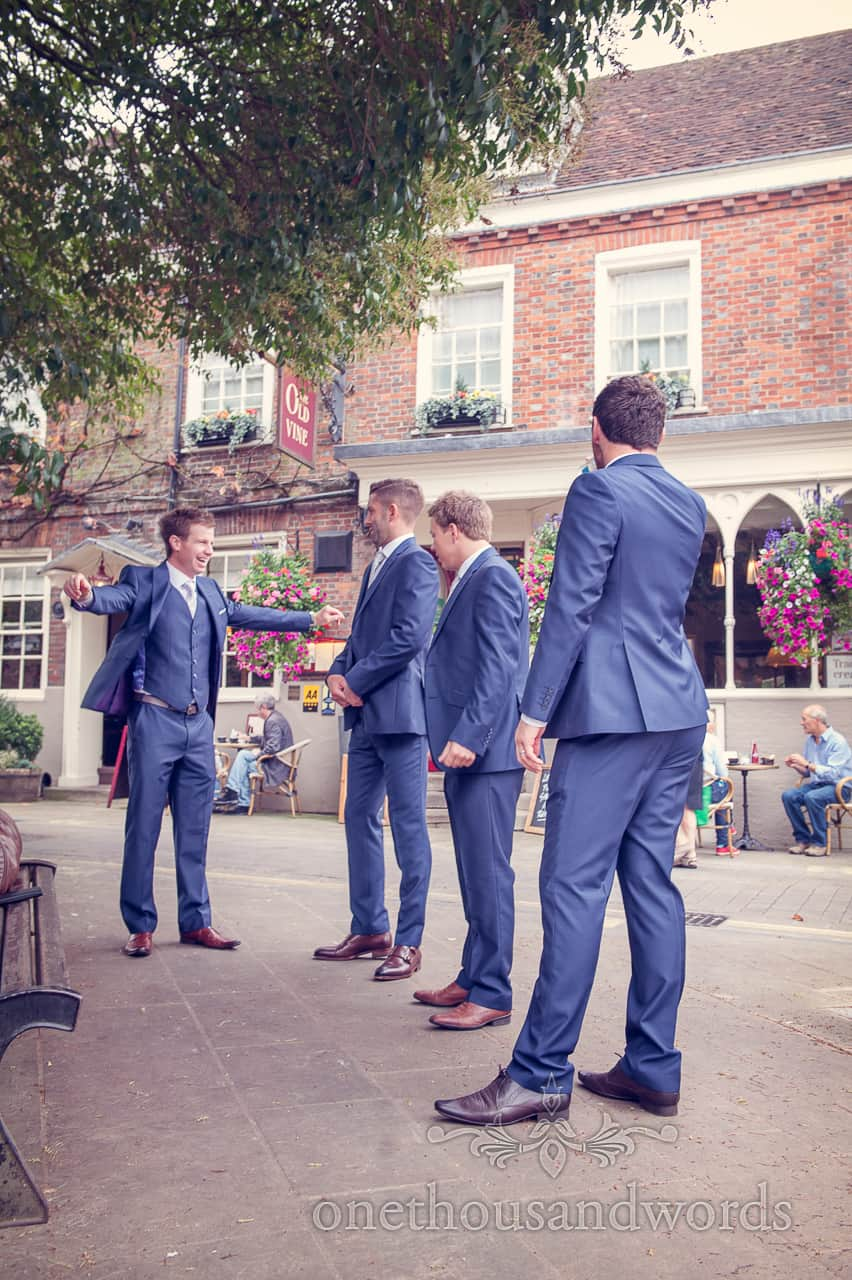 Groomsmen in blue wedding suits outside pub on Wedding Morning