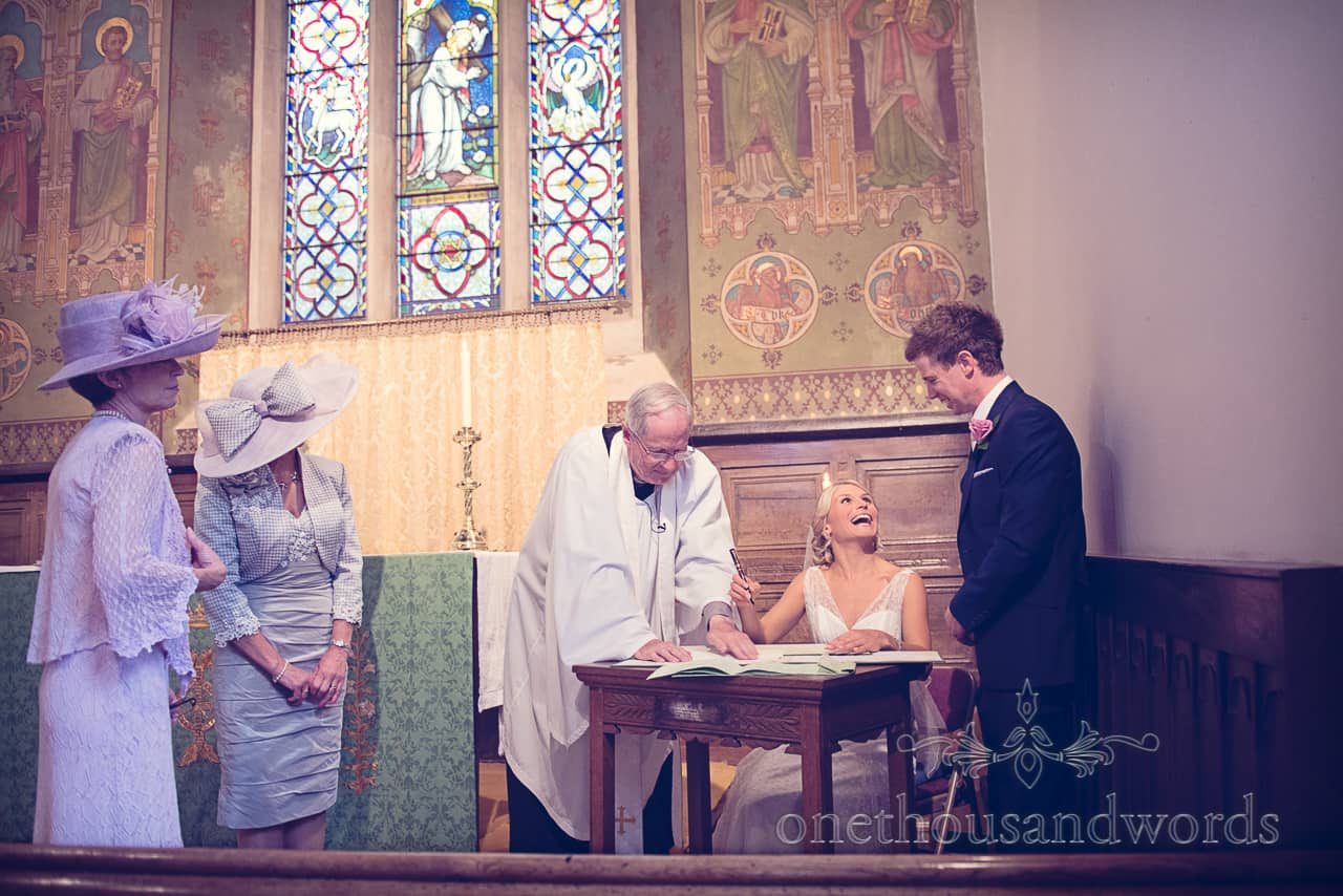 signing the register wedding photographs