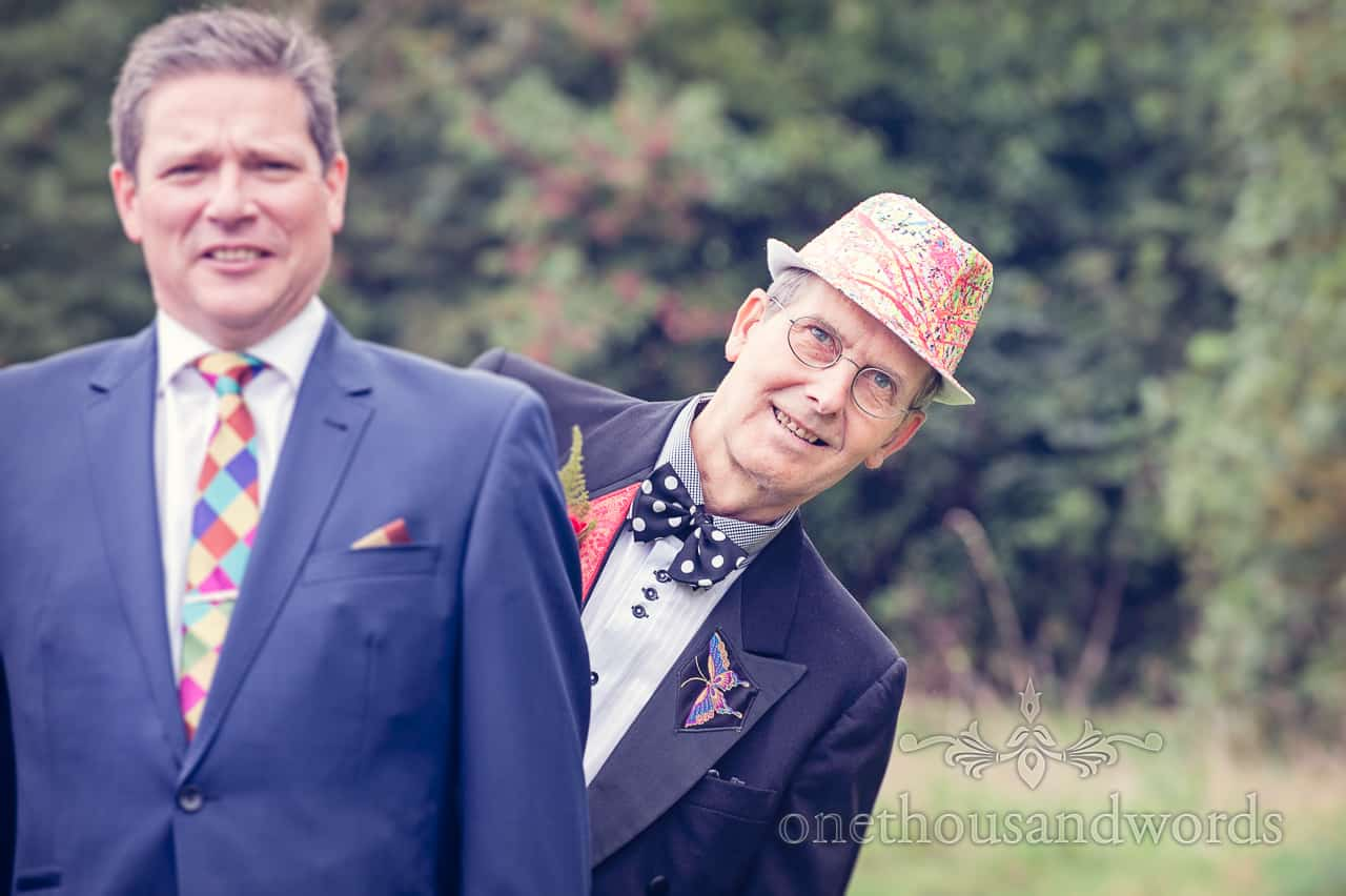 Wedding guest in bright hat portrait photograph