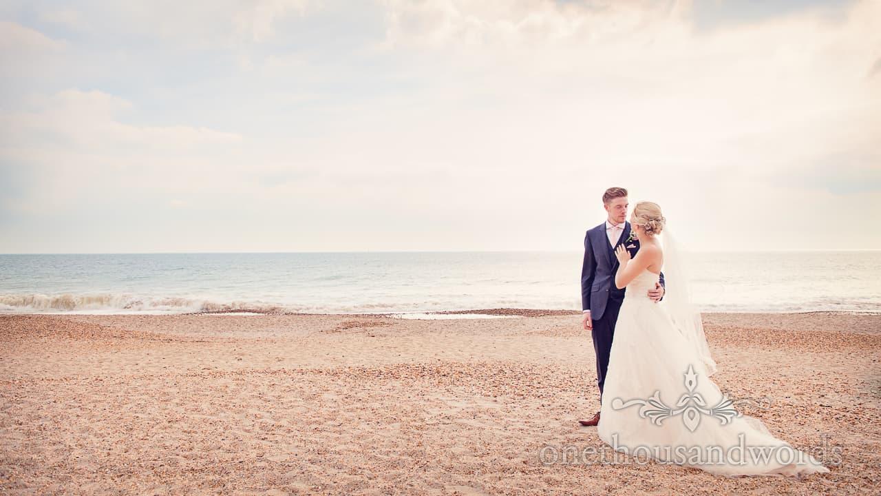 bride adn groom on Dorset beach