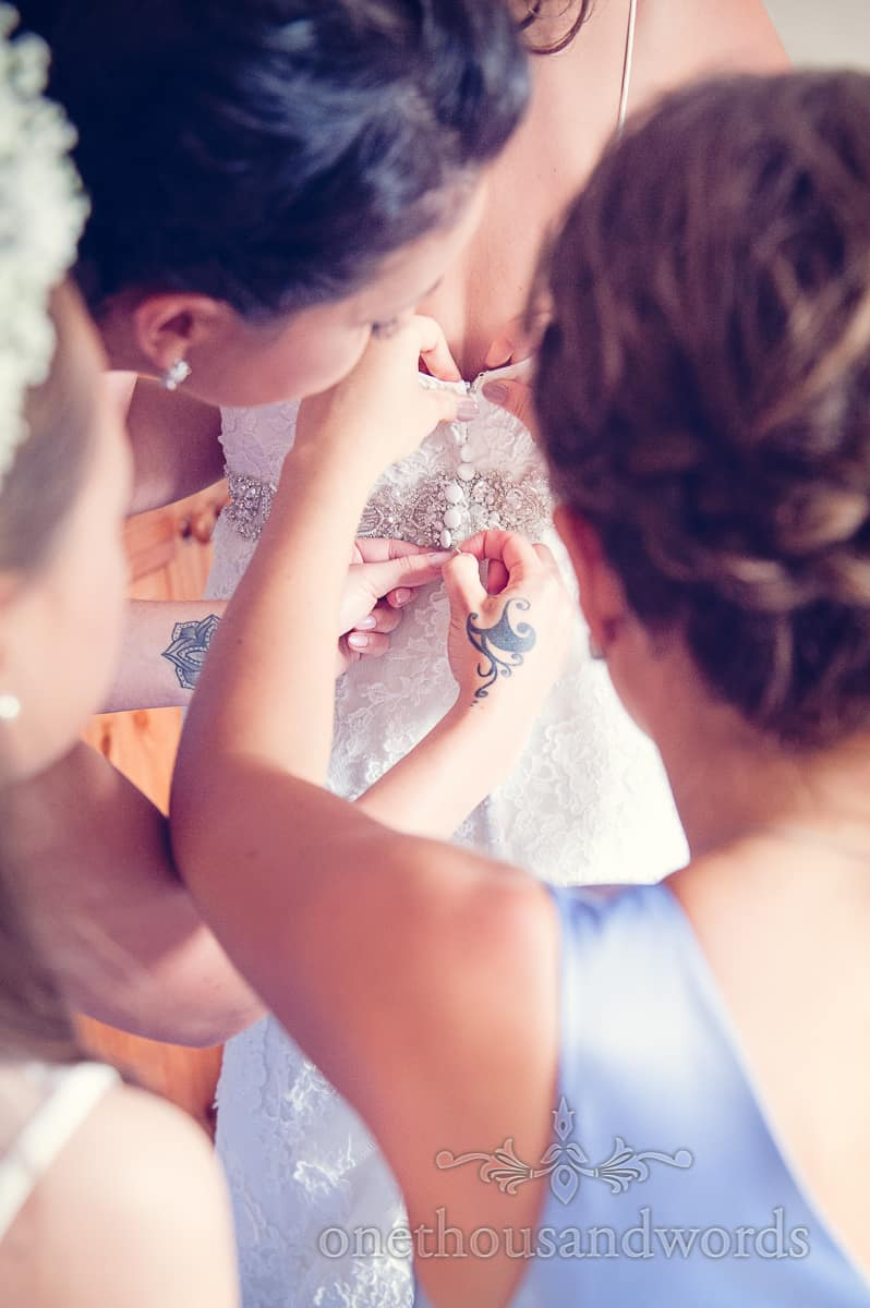 sherborne wedding photographs bride buttoned into dress tattoo