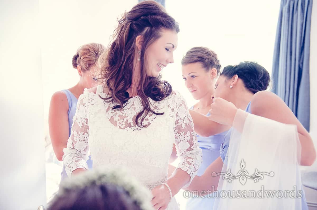 bride into wedding dress on sherbourne wedding morning