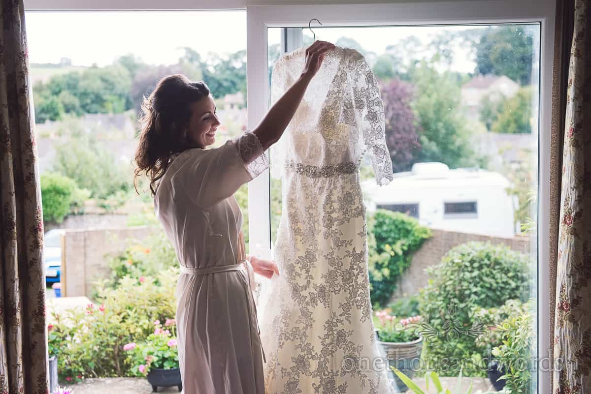Bride with lace detail wedding dress in Sherborne wedding photographs