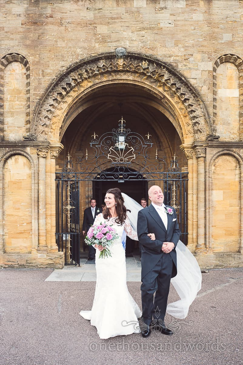 Wedding photograph of bride and groom outside Sherborne Abbey