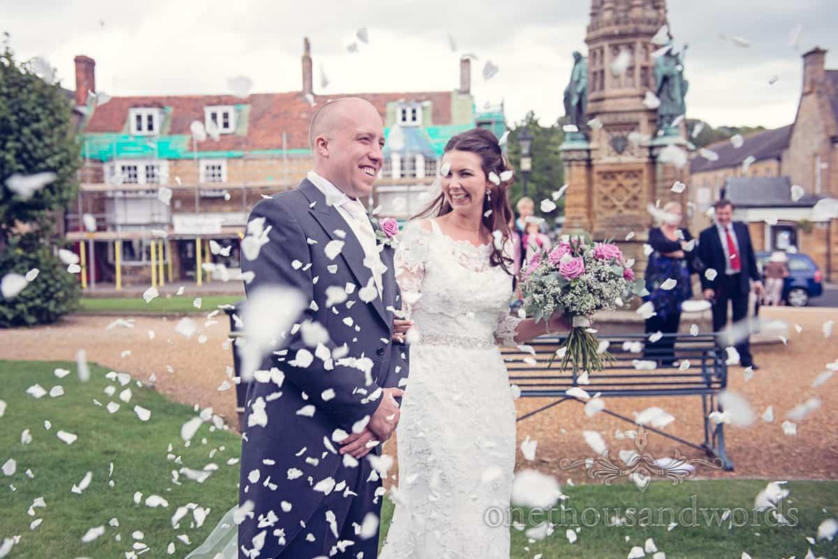Sherborne wedding photographers capture wedding confetti