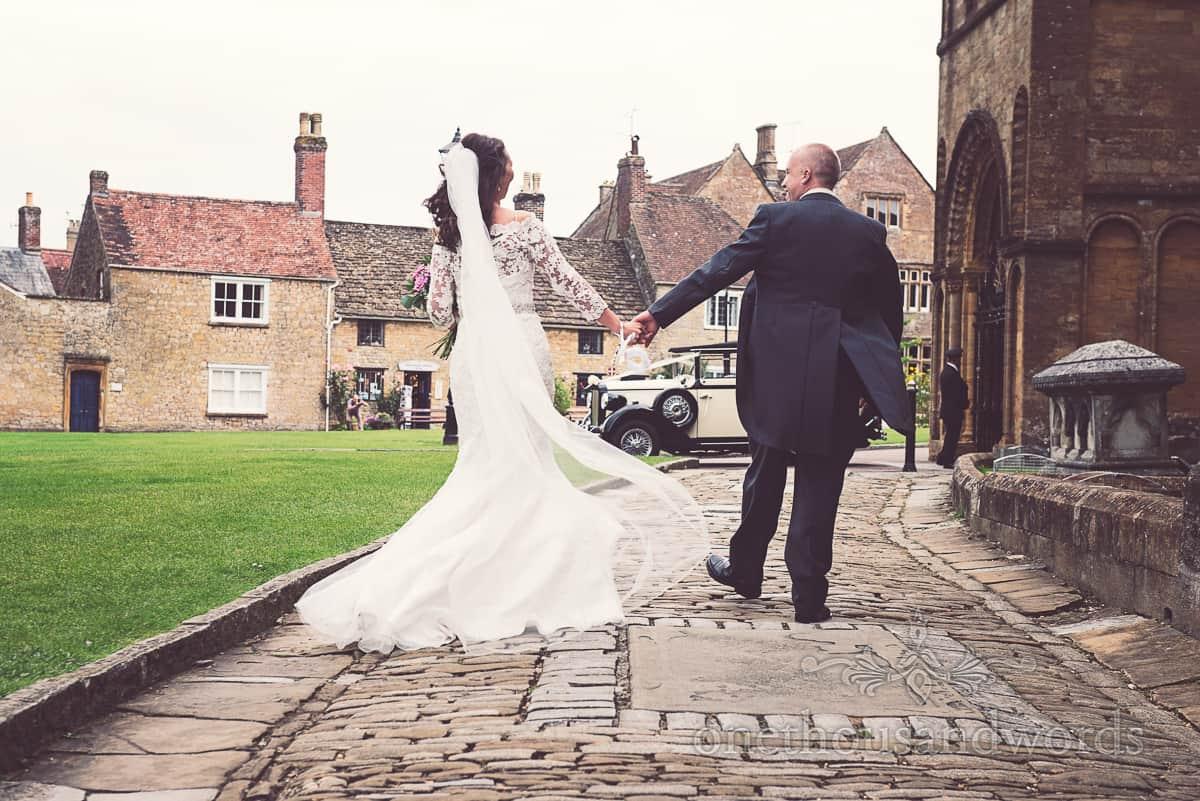 bride and groom leave sherborne wedding photographs