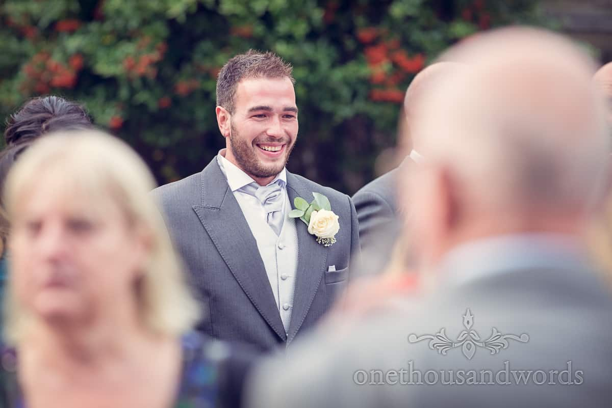 groomsman with button hole at sherborne wedding