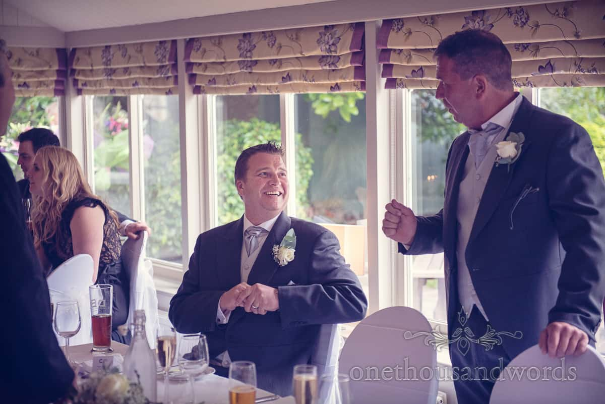 Best man laughing at Eastbury hotel wedding top table