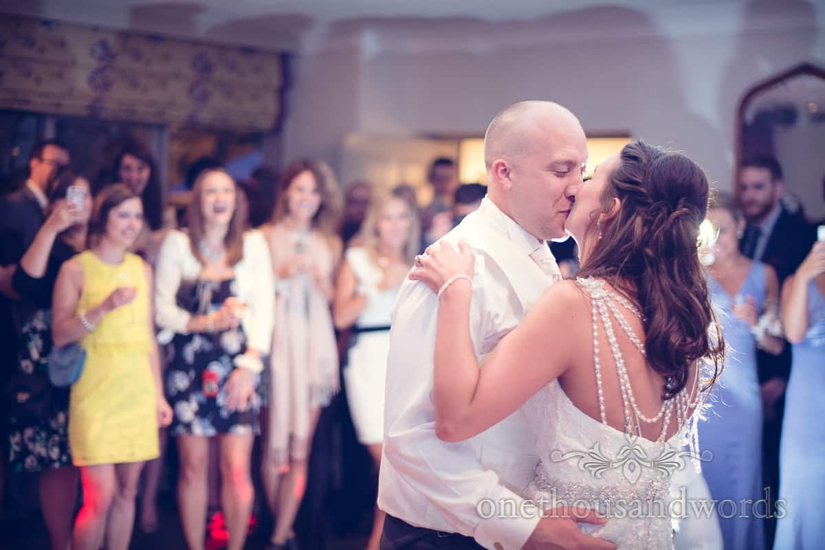 Bride and groom kiss during first dance at Eastbury Hotel wedding