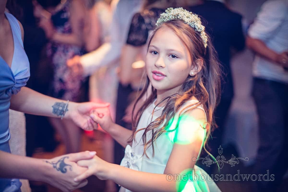 Flower girl dancing at Eastbury Hotel wedding in Sherborne