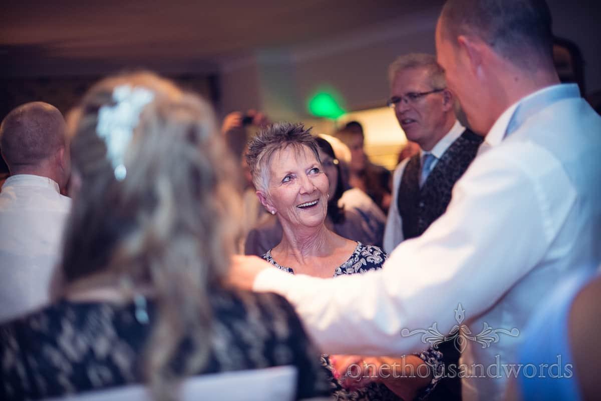 Wedding guests dancing in disco lights at Eastbury Hotel Wedding
