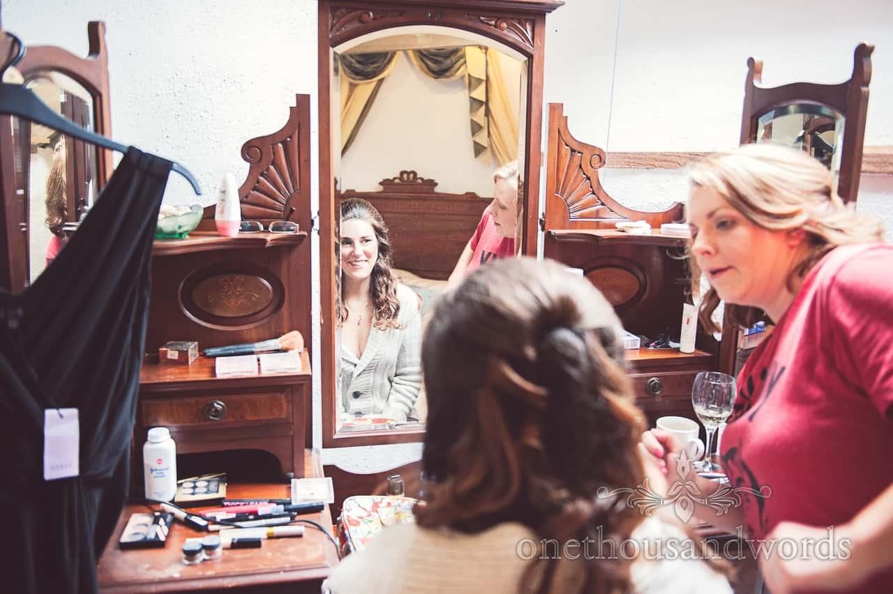 Bridal makeup in mirror on wedding morning