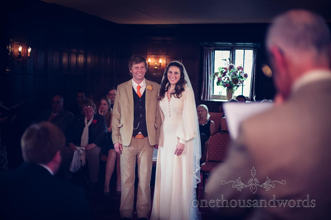 Bride and groom during ceremony at Mortons House Hotel in Corfe