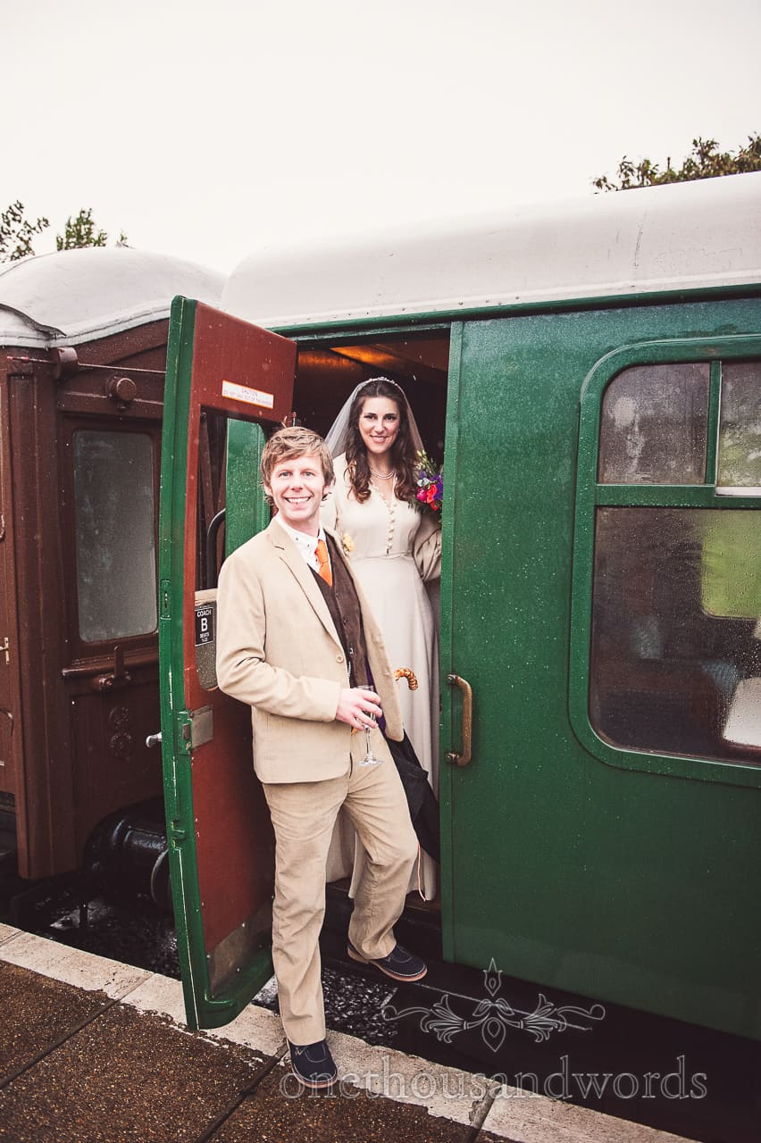 Bride and groom enter with steam train from Purbeck wedding
