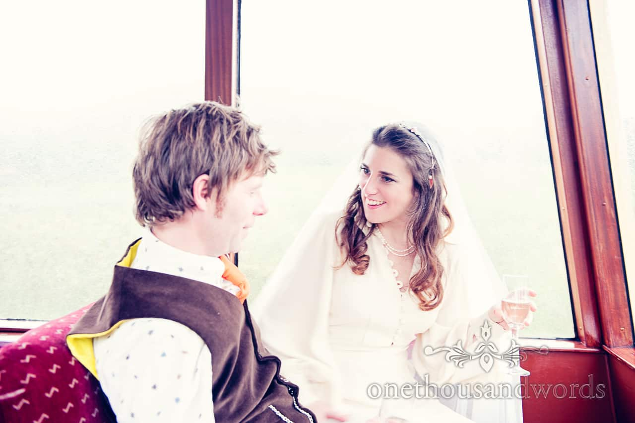 Bride and groom on Swanage steam train during Purbeck wedding