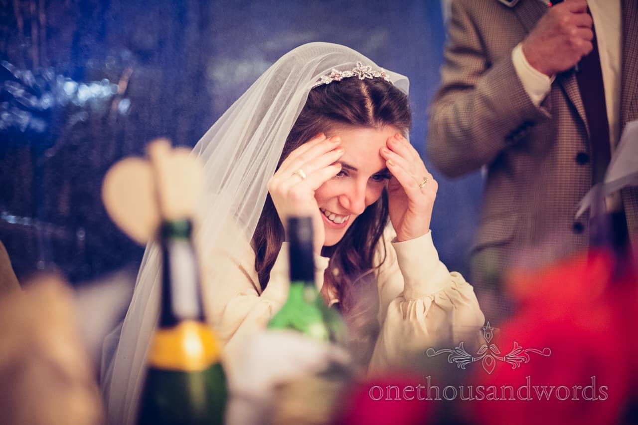 Embarrassed bride holds head during wedding speeches