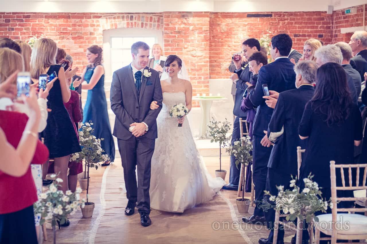 walking down aisle at Sopley Mill Wedding