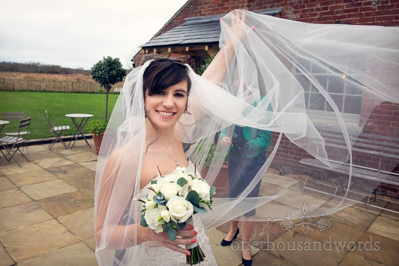 Bride with veil at Sopley Mill Wedding