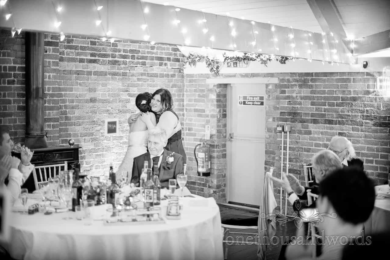 bride and bridesmaid at Sopley Mill Wedding