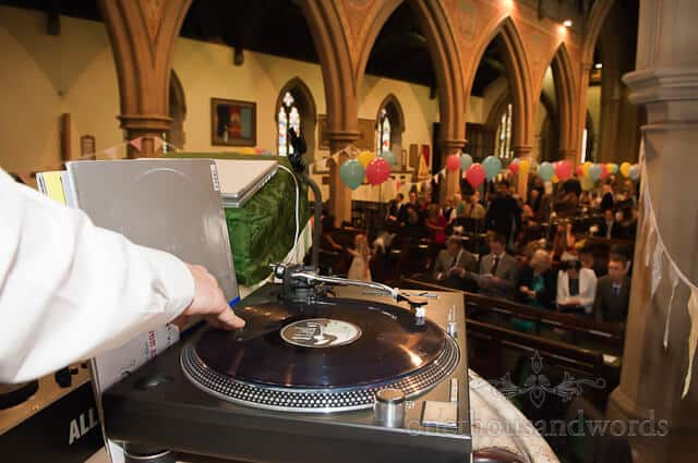 DJ in pulpit by wedding photographer Bournemouth