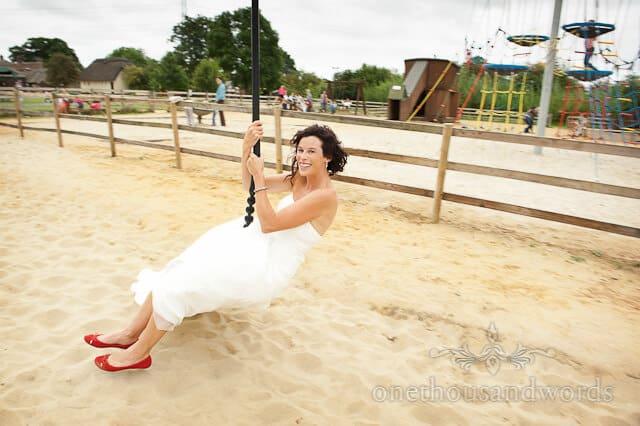 bride on zip line at Honeybrook Farm wedding, Wimborne