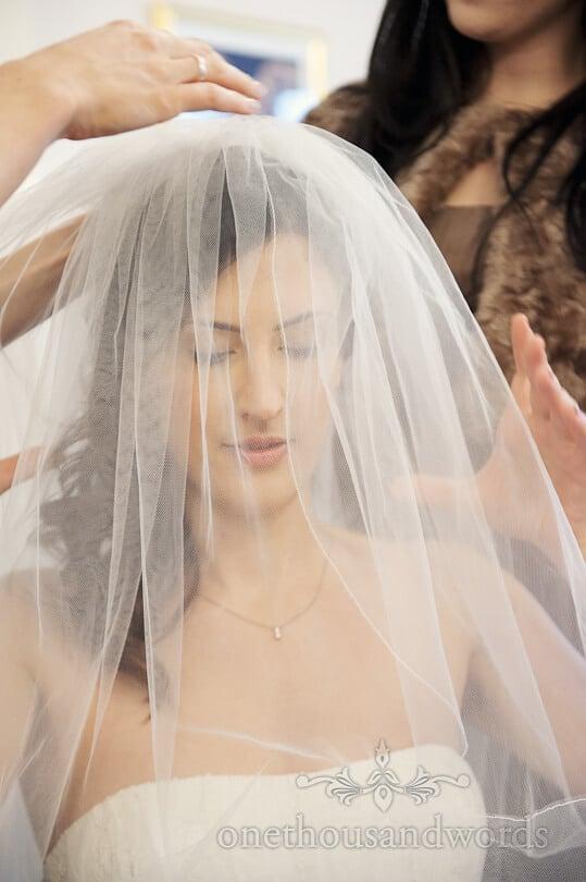 bride photograph through wedding veil