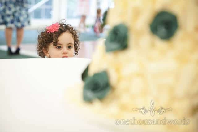 flower girl spies the wedding cake at Sherborne Castle wedding