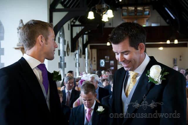 groom laughing at church wedding service