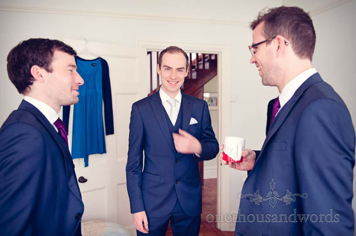 Groom in blue suit on Purbeck wedding morning