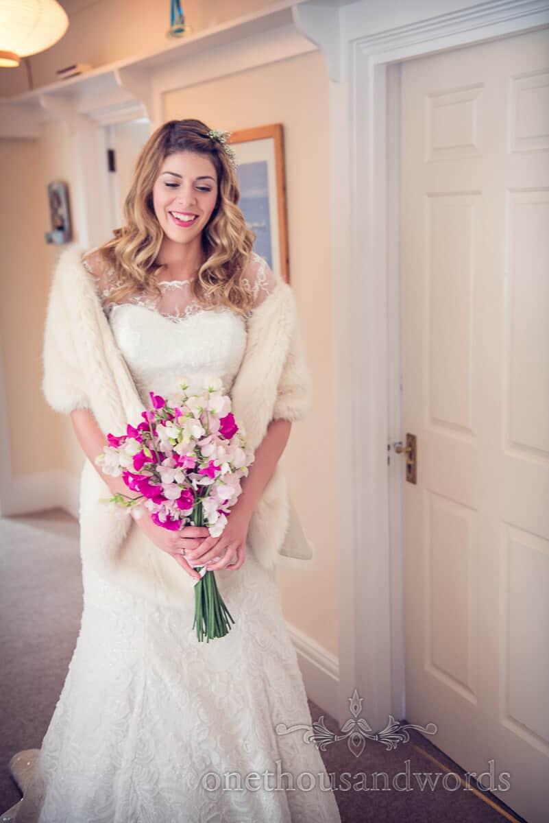 bride in fur shawl with wedding flowers