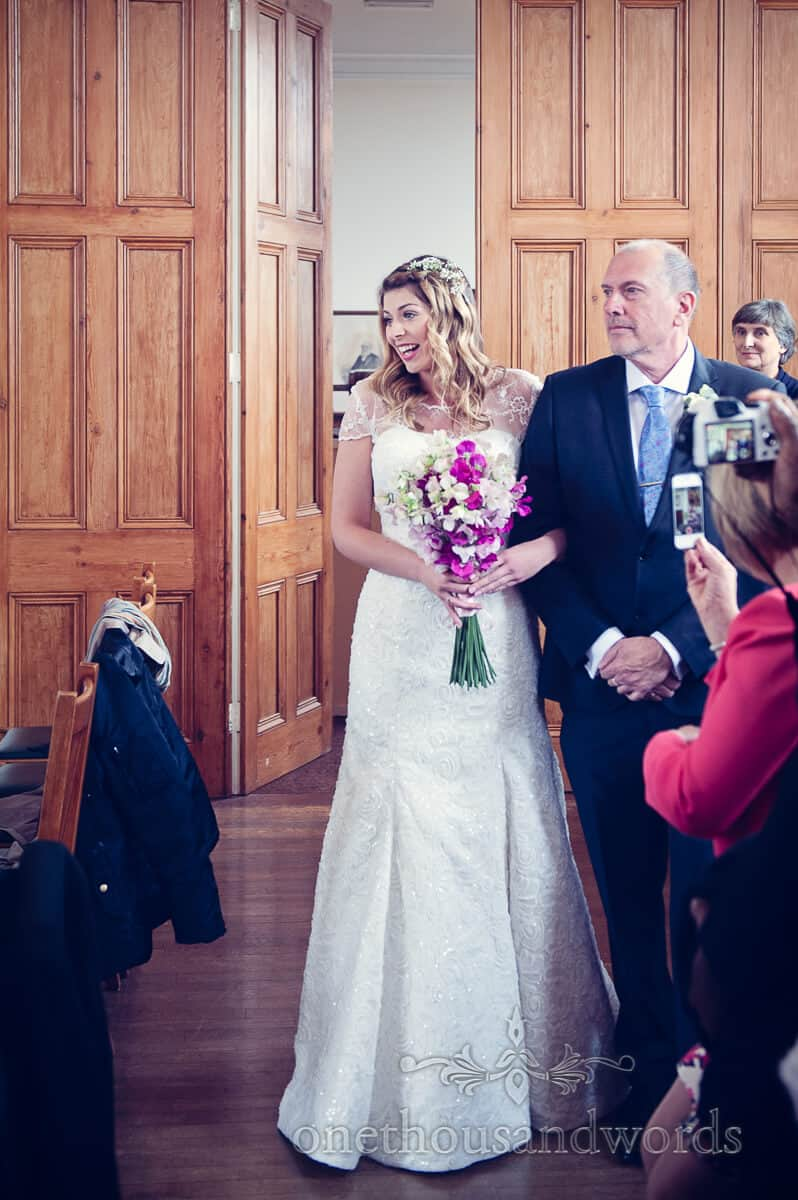 bride enters wedding ceremony at Swanage Town Hall wedding