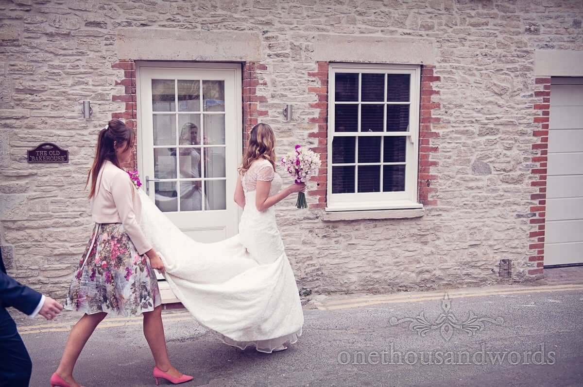bride walks through swanage purbeck wedding photographs