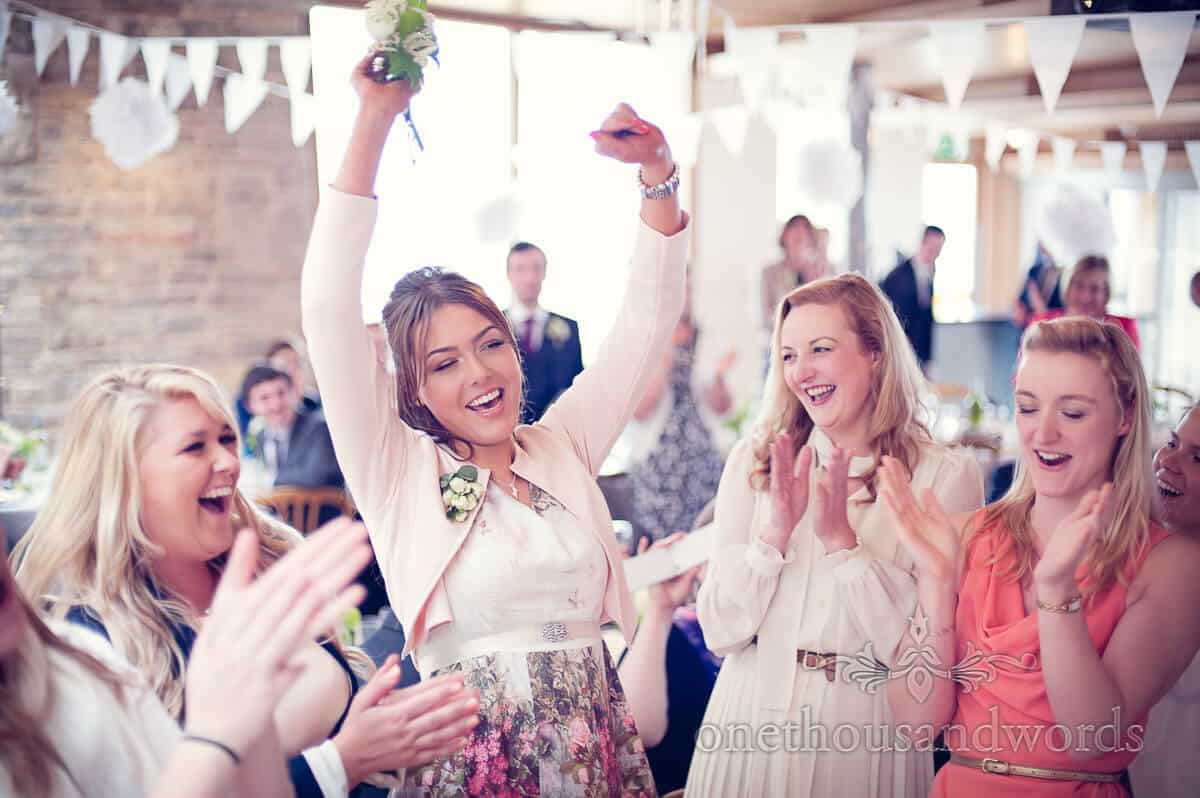 bridesmaid catches the wedding bouquet