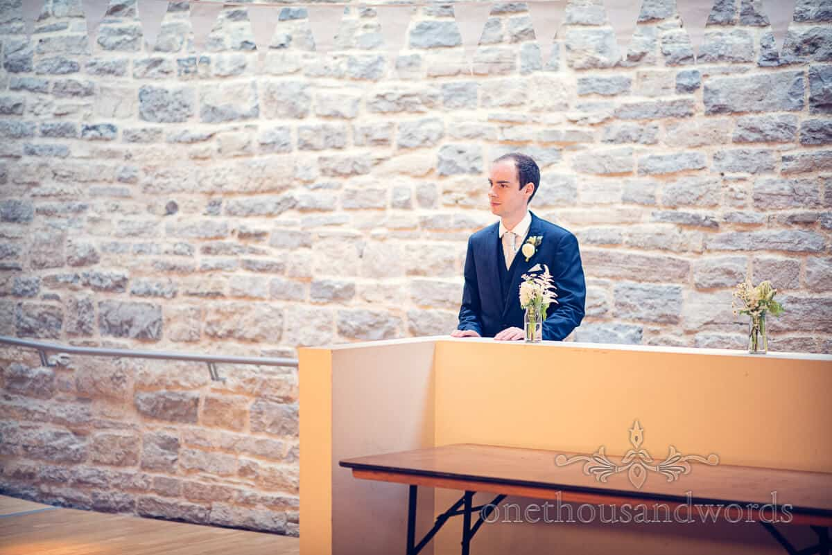 groom in blue suit at Durlston Castle wedding