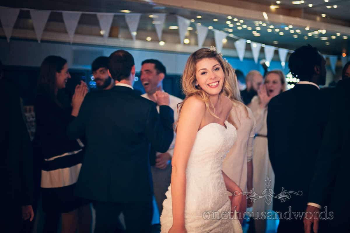 Bride dancing at Durlston Castle wedding